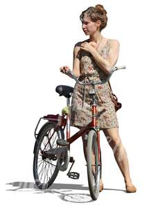 cut out woman in a dress standing by a bicycle