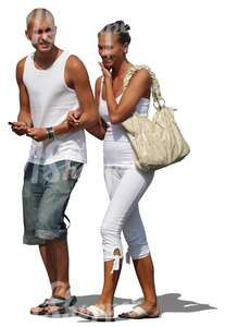 cut out couple in white walking arm in arm