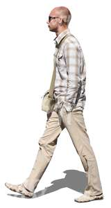 cut out man in a beige outfit walking