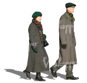 man and woman in grey winter coats walking