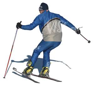 cut out man skiing downhill