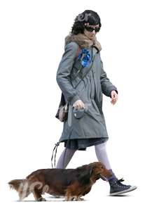 cut out woman walking a dachshund