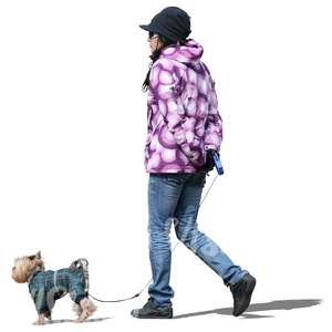 cut out woman walking a dog in winter
