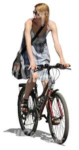 woman in a dress riding a bike