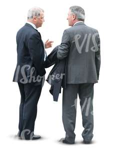 two businessmen standing and talking