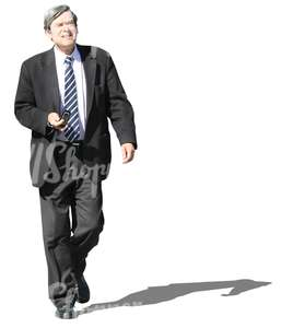 grey-haired businessman walking