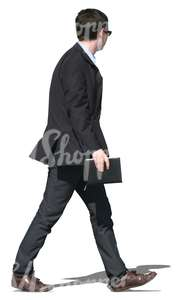 young businessman in a black suit walking