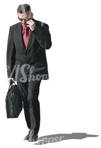 businessman with a briefcase talking on the phone