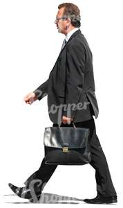 businessman walking with briefcase in hand