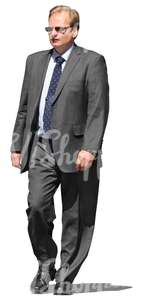 cut out businessman in a grey suit walking
