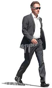 businessman with sunglasses walking