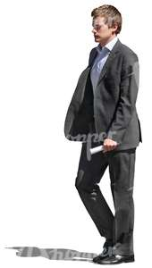 cut out young businessman walking