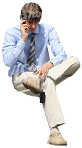 cut out businessman sitting and talking on the phone