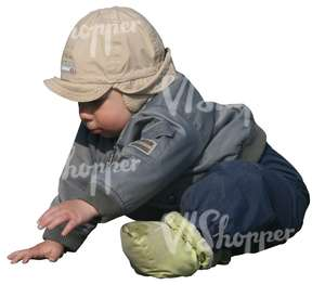 small boy playing on the ground