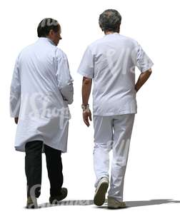 two cut out male doctors walking