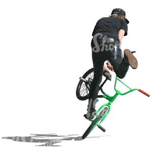 cut out teenager doing a stunt on bmx