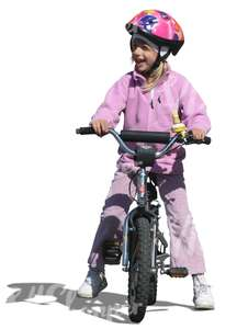 cut out girl with a helmet riding a bike