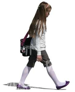 young girl with a scool bag walking