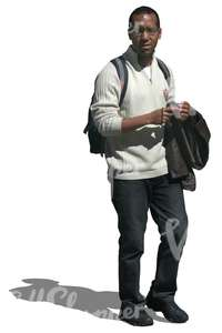 cut out black man in a white sweater walking