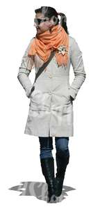 cut out woman in a white coat walking