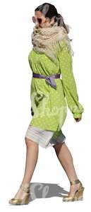 cut out woman in a green dress walking