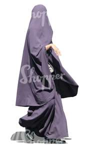 muslim woman in a purple abaya walking