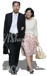 asian couple in formal clothes walking arm in arm
