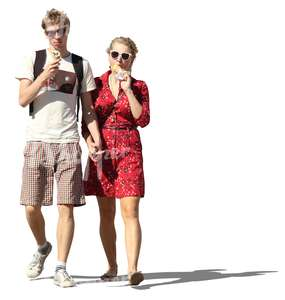 couple walking hand in hand and eating ice cream