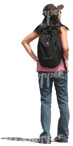 woman with a backpack standing and looking