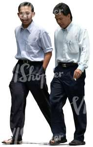 two asian businessmen walking and talking