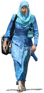 cut out muslim woman in a blue dress walking