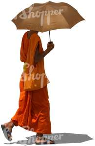 cut out buddhist monk walking with an umbrella