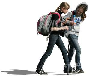 two teenage girls with backpacks walking together