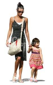 mother and daughter in summer dresses walking together