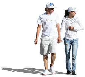 couple in white clothes walking hand in hand