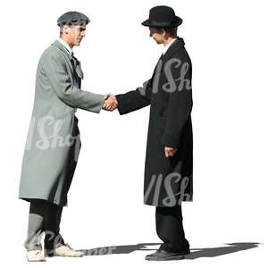 two men with hats shaking hands