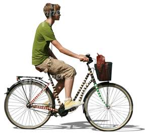 young man with headphones riding a bike
