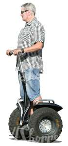 grey-haired man riding a segway