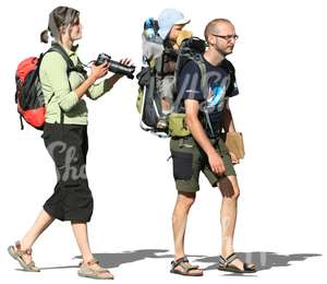 travelling family walking with backpacks