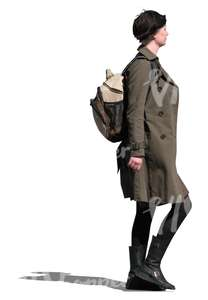woman in a brown trench coat walking