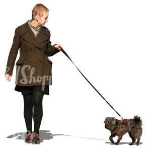 woman walking with a small dog