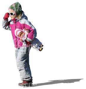 girl with a baby doll walking