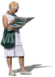 woman standing and reading a newspaper
