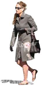 woman in a grey autumn coat walking