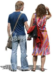 man and woman standing and holding hands
