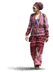 woman in a pink bohemian outfit walking