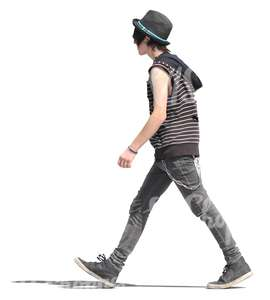 young man in punk style outfit walking