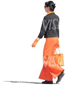woman in a black and orange outfit walking