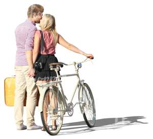 couple with a bike standing and kissing