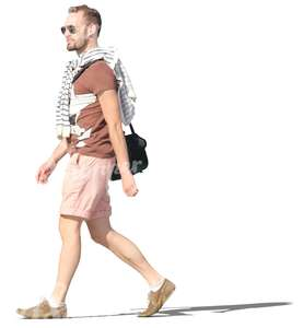 man in shorts walking happily